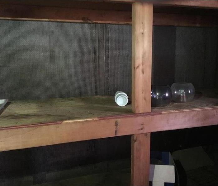 Wood cabin with shelves with small items on the shelves
