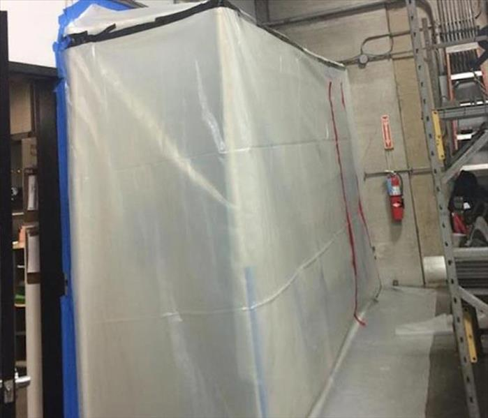 Poly sheeting containment barrier to isolate the work area
