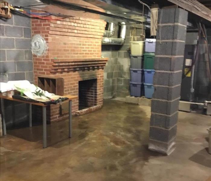 basement, wet floor, massive brick fireplace and cinder block support column