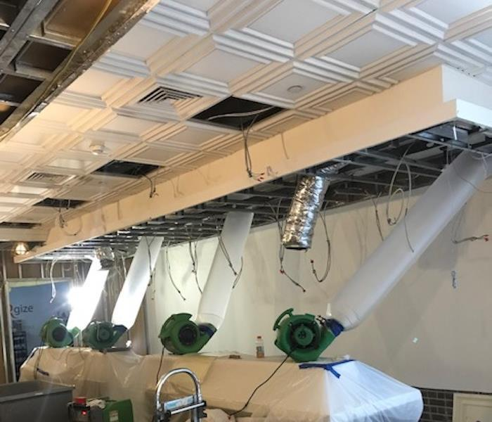 SERVPRO equipment forcing air into the water damaged ceiling