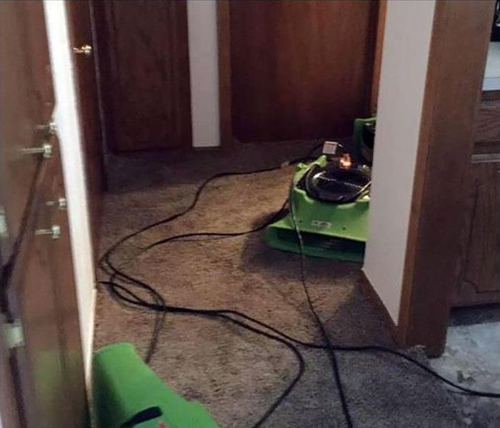 flooding caused water damage to the carpeting