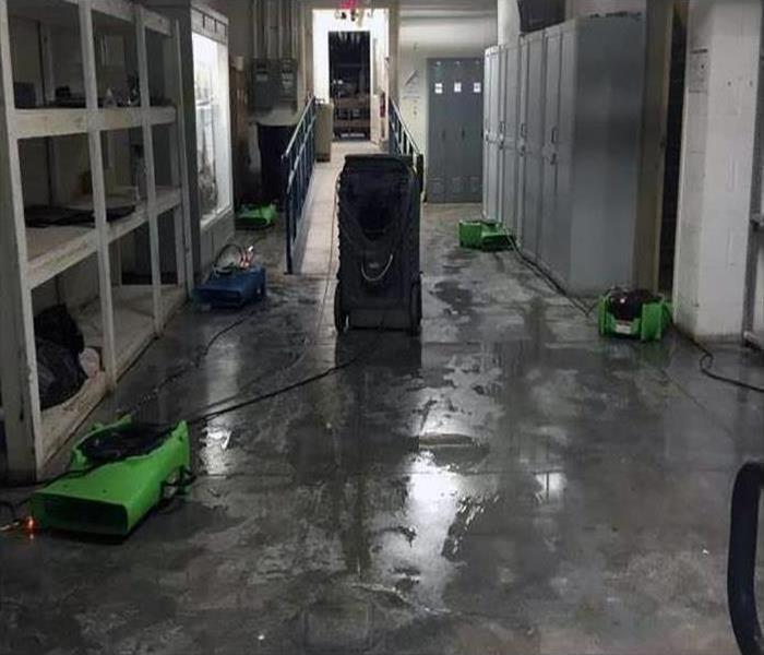water damaged warehouse floors